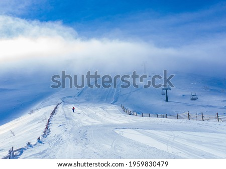 A snowfield on a cold winter day against the cloudy sky Stock photo ©