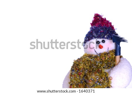 A snowman doll, holding a rake, isolated on a white background. Space for text.