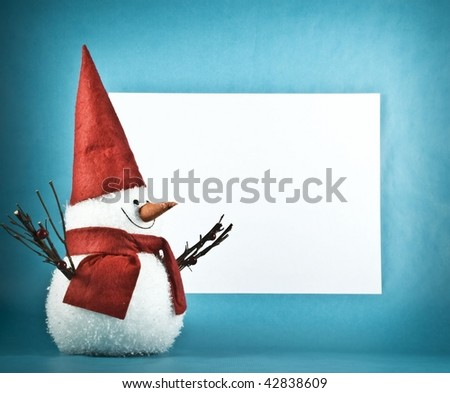 a snowman in a red cap on a blue background