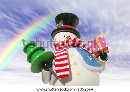 A snowman under the rainbow carrying a christmas tree and present