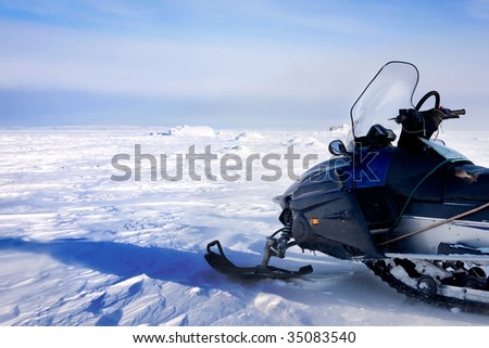 A snowmobile on a barren winter landscape Сток-фото ©