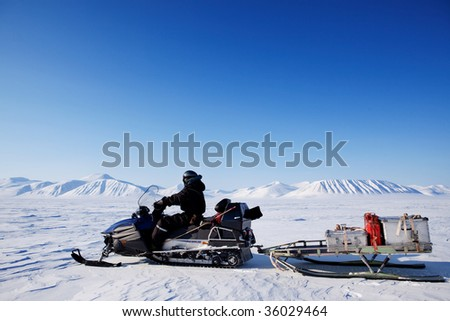 A snowmobile on an arctic expedition on a frozen lake
