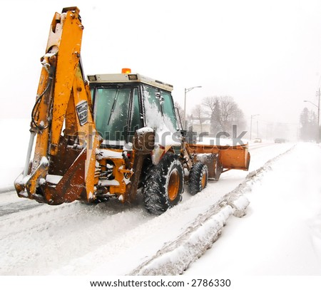 A snowplow clearing a road