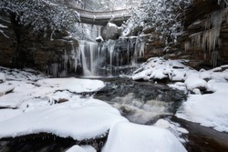 A snowy scene at Elakala Falls in Blackwater Falls State Park, Davis, West Virginia.