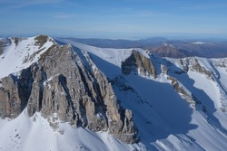A snowy view of a mountain rockface in the italian apennine, its name is