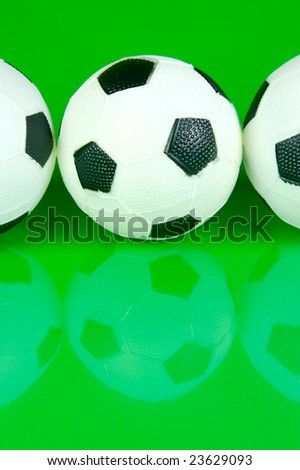 A soccer ball isolated against a green background #23629093