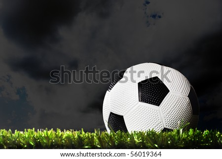 a Soccer ball on a soccer field at night