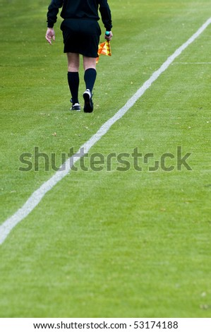 a soccer linesman referee in action during a game