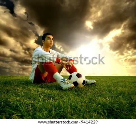 a soccer player sitting on the field
