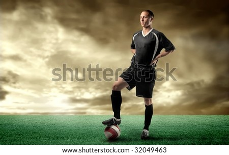 a soccer player standing in a grass field