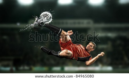 a soccer player with the ball form water