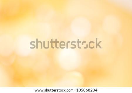 A soft glowing golden yellow bokeh background in landscape (horizontal) orientation.
