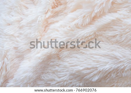 a soft white, plush micro fleece fabric blanket is swirled into a circular pattern background Foto stock ©