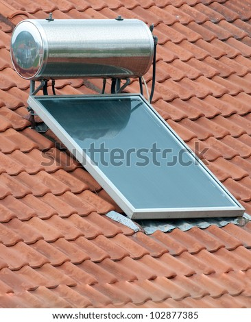 A solar panel used to heat water on a roof