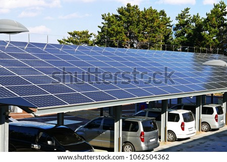 A solar power plant installed on top of a parking lot #1062504362