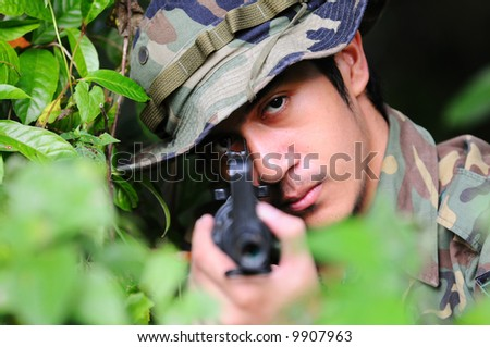 A soldier aiming his rifle