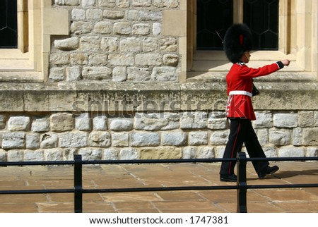 A soldier making the guard in front of Tower of London Quee's Treasure building, in London