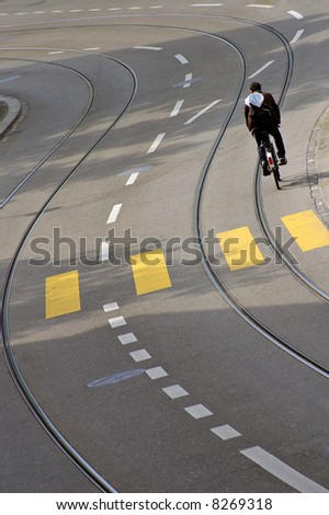 A solitary cyclist on an empty street in Zurich, Switzerland