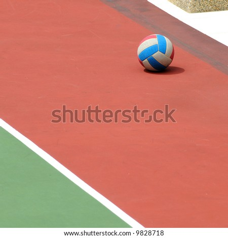 A solitary netball on the netball court - stock photo