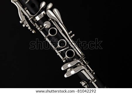 A soprano clarinet isolated against a black background - stock photo