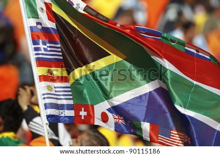 A South Africa flag bordered by various participating country flags of the 2010 World Cup.