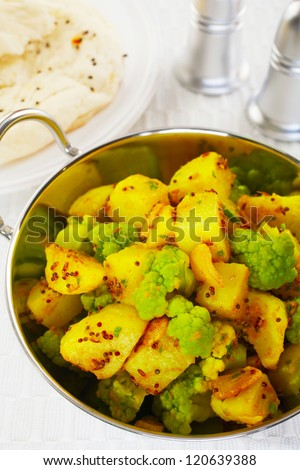 A South Indian dish, cauliflower and potato curry is known as aloo ghobi in the West. It's flavoured with mustard seeds, cumin seeds, garlic and chilli. - stock photo