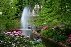 a spa park with a fountain, an oasis of calm
