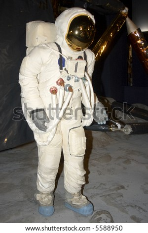 A  space man on the moon with lander behind