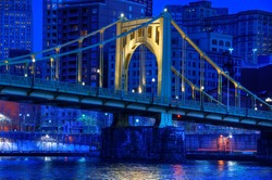 A span of the Roberto Clemente Bridge over the Allegheny River in downtown Pittsburgh, Pennsylvania at night.
