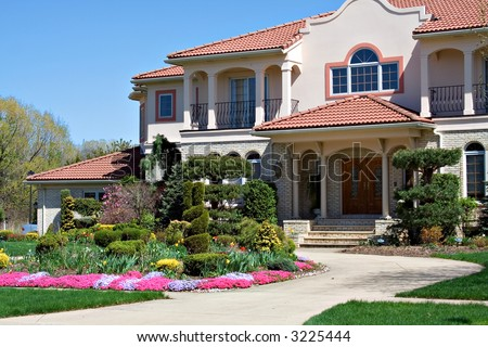 A Spanish style architecture - home in Ohio, blue sky, pretty flowers.