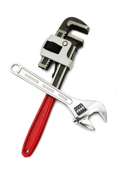 A spanner cross over pipe wrench isolated on white background.