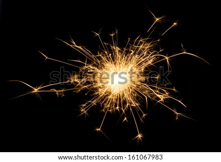 A spark over black background