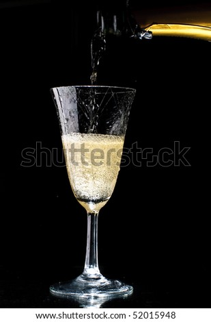 A sparkling wine glass with sparkling wine isolated on a black background