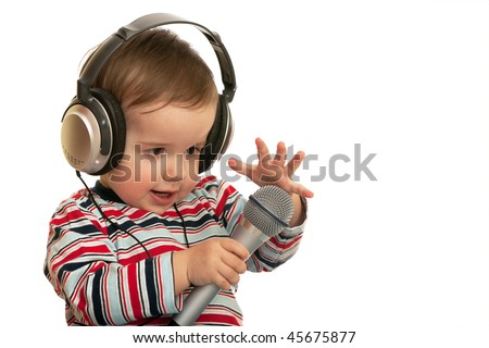 A speaking toddler with headphones and microphone; isolated on the white background