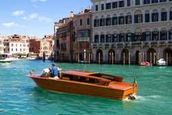 A specific water taxi on The Grand Canal in Venice.