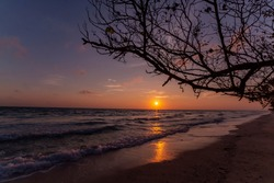 A spectacular sunrise over the Andaman sea shot from Kala Pathar Beach at Havelock Island a.k.a Swaraj Island. The tree silhouette along with the waves bashing the shore adds the character to the shot