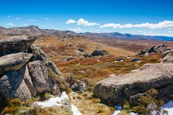 A spectacular view across the valley on the Kosciuszko walk near the summit of Thredo in Snowy Mountains, New South Wales, Australia