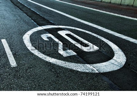 a speed limit sign painted on the road