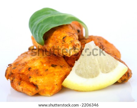 A spicy summer starter, simple lemon chicken salad macro close up isolated on white