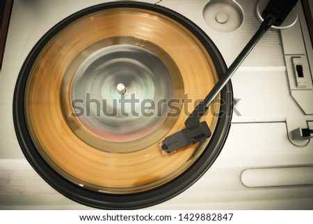 A spinning 45 record on a record player #1429882847