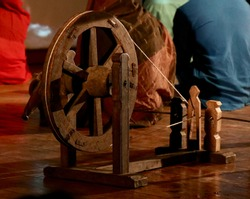 A spinning wheel charkha is a device for spinning thread or yarn from fibres