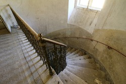 a spiral staircase in an old castle inside