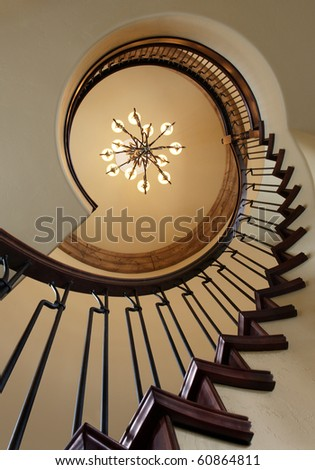 A spiral staircase in an upscale modern home. - stock photo
