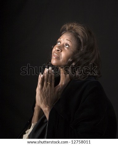 A spiritual  woman looking to heaven and praying
