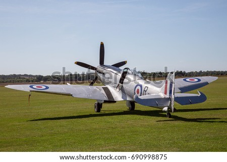 A Spitfire sitting on the grass waiting to perform at the Duxford air show Sept 2016