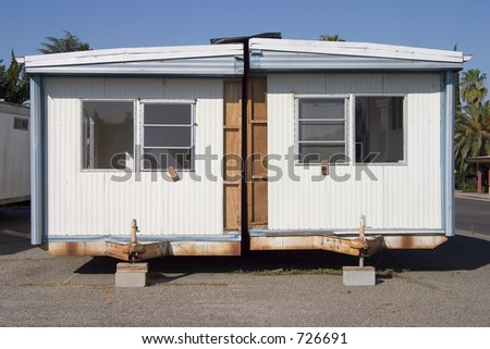 A split in half mobile home. - stock photo