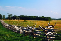 A split rail fence traverses the sacred grounds of Gettysburg National Battlefield