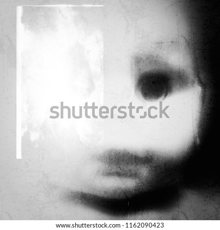 A spooky and disturbing image of a doll on a grunge and old photo effect.