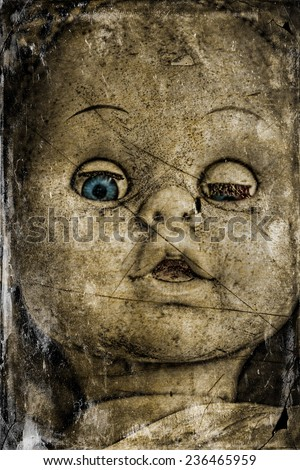 Stock Photo A spooky and disturbing image of a doll on a grunge and old photo effect.