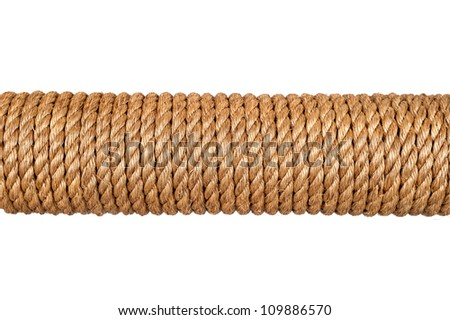 A spool of three-strand hemp rope isolated on white.